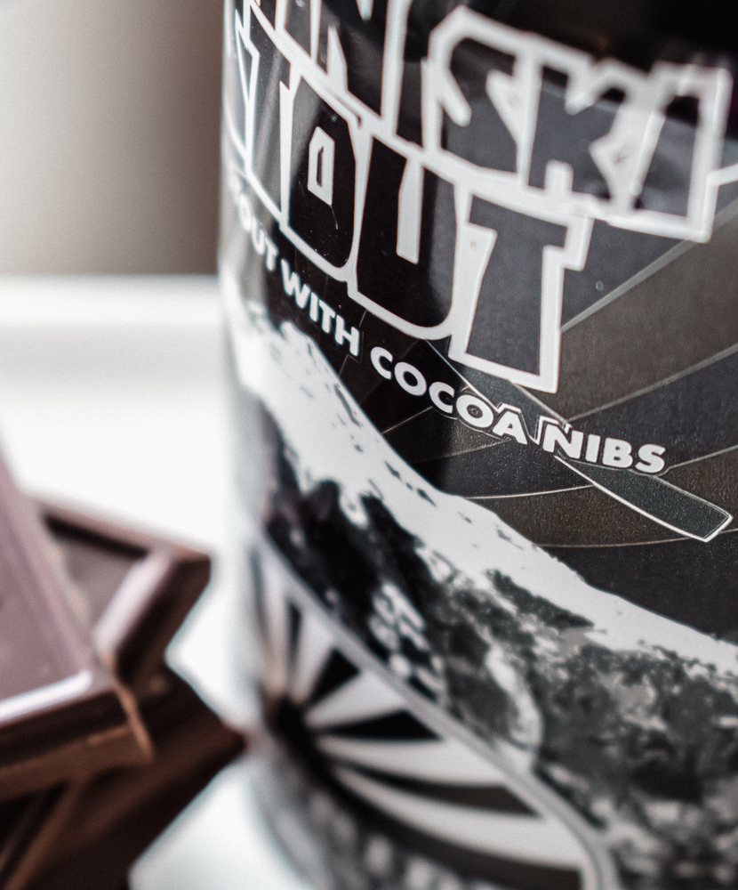 Telluride Ski-In-Ski-Stout can next to chocolate that will be used for Coffee Stout Beer Brownies