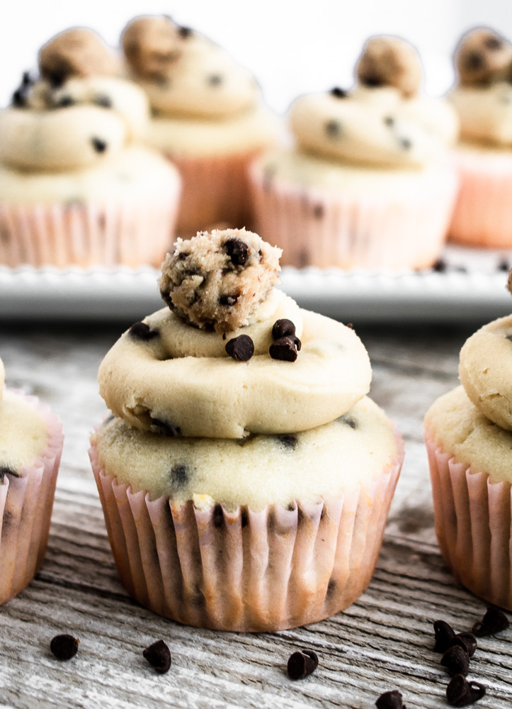 Close up photo of edible cookie dough frosting on a chocolate chip cupcake
