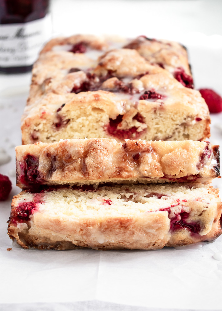 Slices of lemon raspberry cake on parchment paper