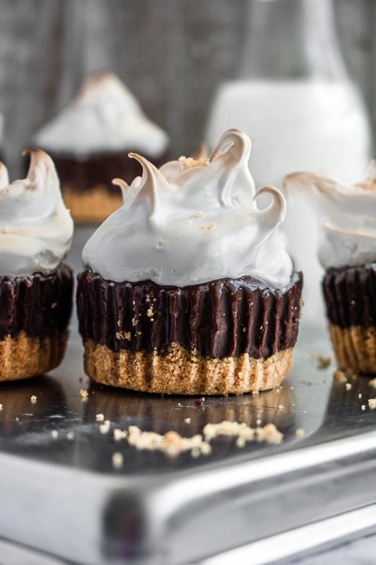 Three mini s'more's cheesecakes on a tin platter