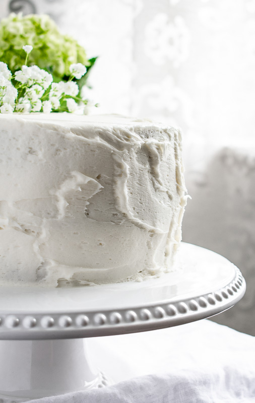 Cream cheese frosting on a carrot layer cake