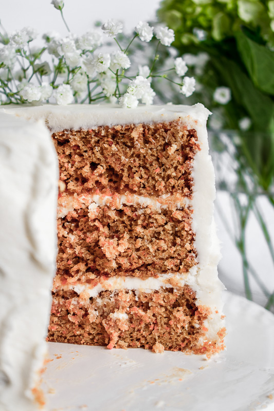 Close up shot of carrot layer cake with peach jam between the layers