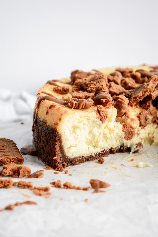 Cookie butter cheesecake with slice taken out
