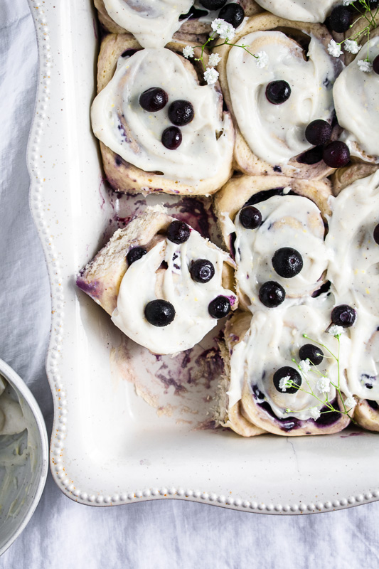 Blueberry cinnamon rolls in a white pan