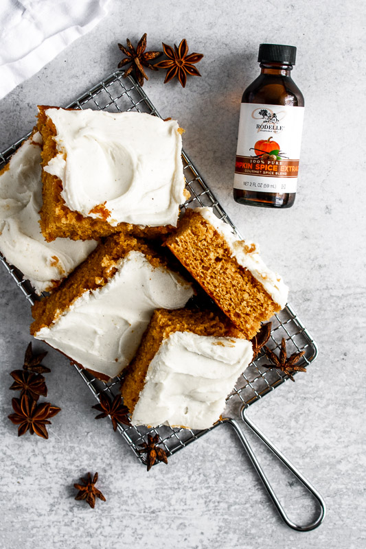 Pumpkin spice bars on a wire rack with Rodelle Pumpkin Spice Extract