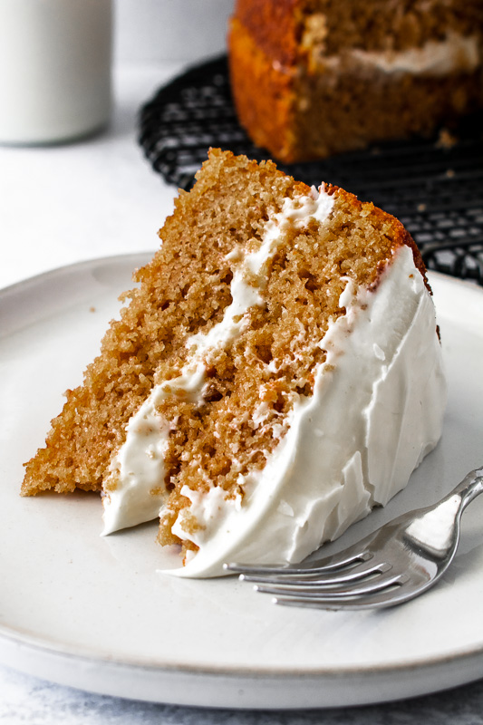 Slice of spice cake on a white plate