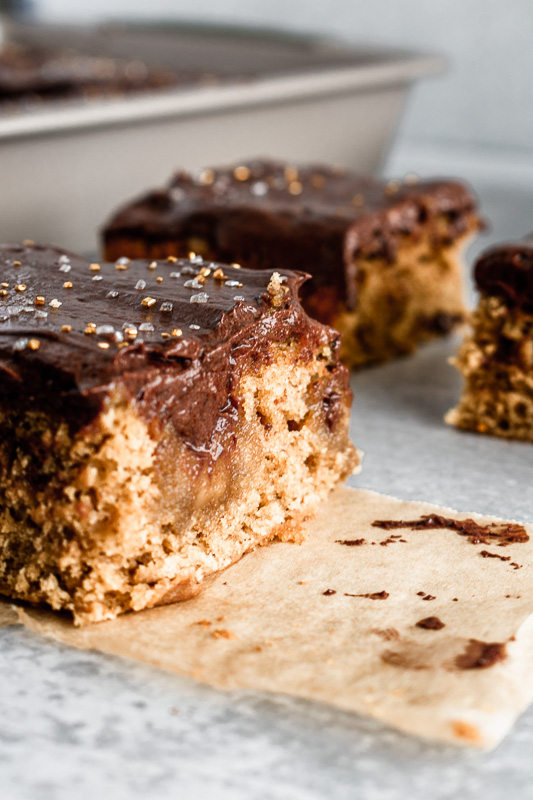 Slices of coffee caramel sheet cake on parchment paper
