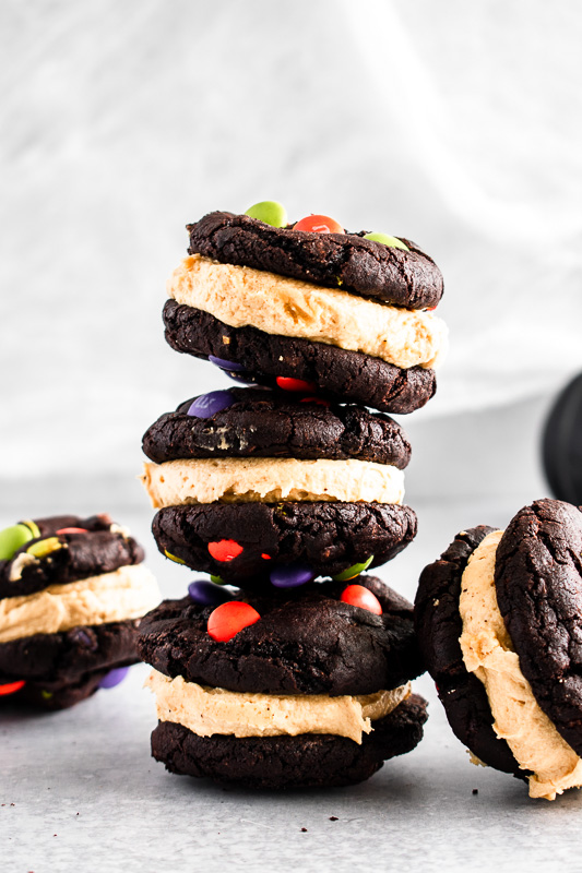 Dark Chocolate Peanut Butter Sandwich Cookies stacked on top of each other