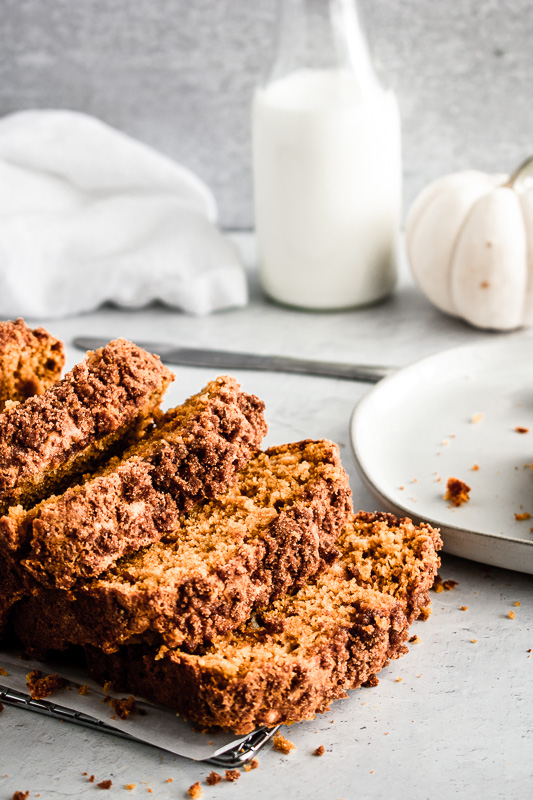 Slices of pumpkin bread with crumbly streusel topping