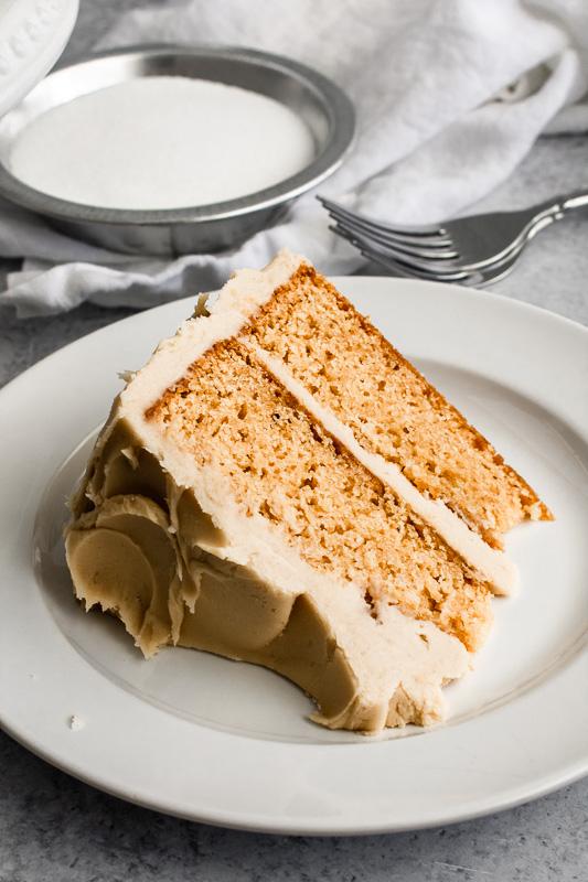 Burnt sugar cake slice on a white plate
