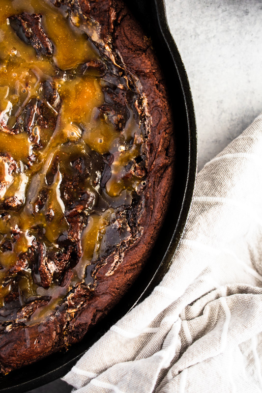 Homemade salted caramel on a skillet brownie