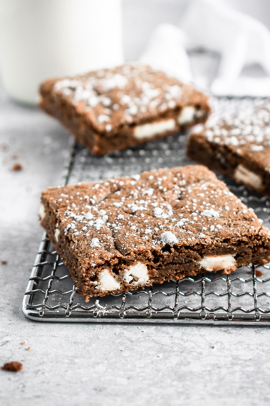 Close up on gingerbread blondies with large white chocolate chunks