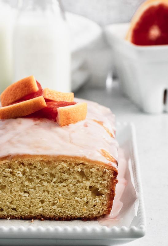 Close up of blood orange loaf cake with slice taken out