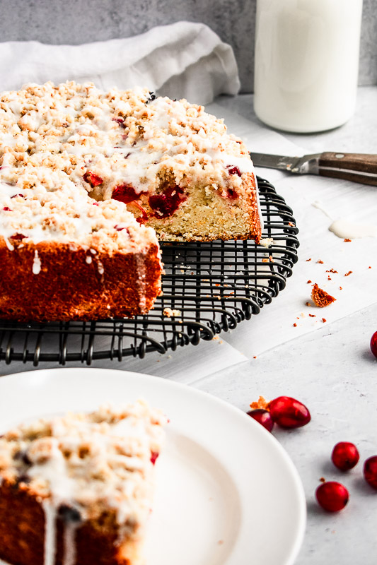 Side view of cranberry coffee cake with slice cut out