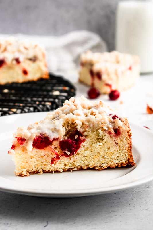 Cranberry citrus coffee cake slices on white plates