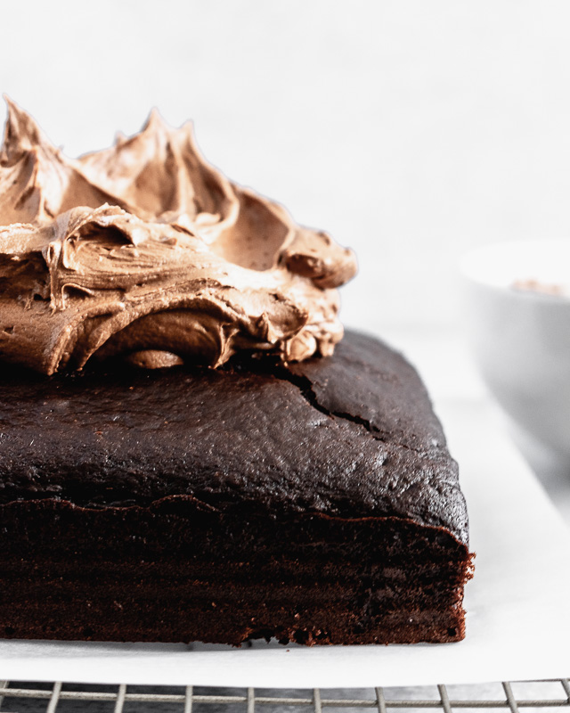 Dark chocolate buttercream on top of a chocolate snack cake