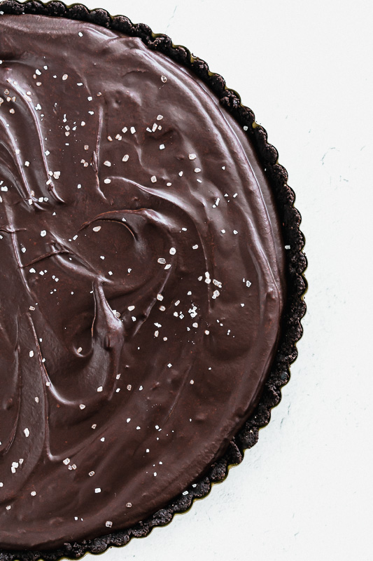 Top view of salted dark chocolate tart in a pan