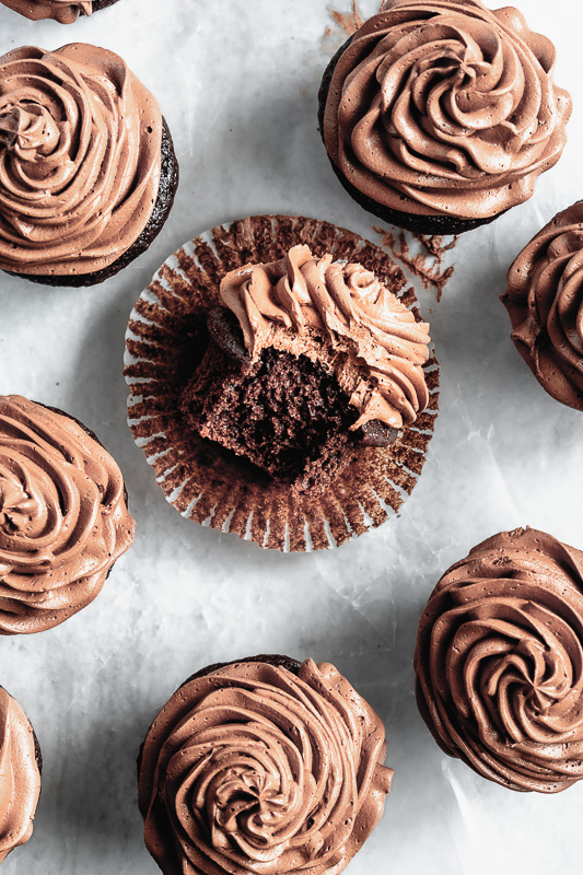 Double dark chocolate cupcake with bite taken out of it
