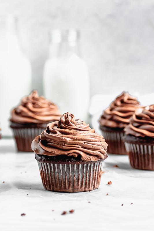 Dark chocolate buttercream on top of a double dark chocolate cupcake
