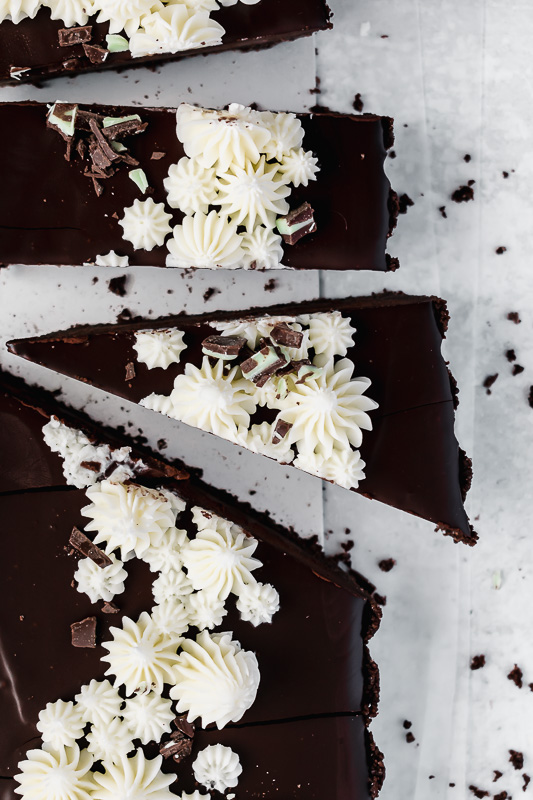 Slices of mint chocolate tart on wax paper