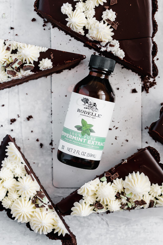 Rodelle peppermint extract in the middle of slices of dark chocolate mint tart