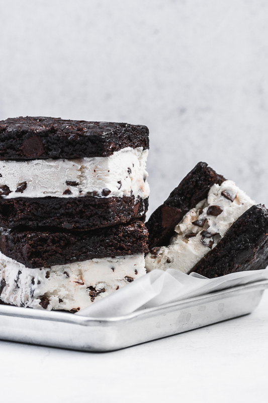 Two mint brownie ice cream sandwiches stacked on top of each other