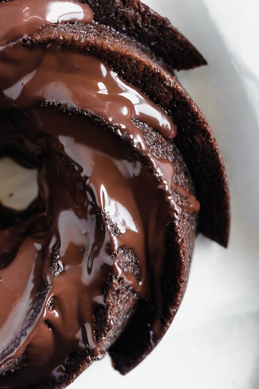 Dark chocolate ganache drizzled over the top of a dark chocolate chip bundt cake