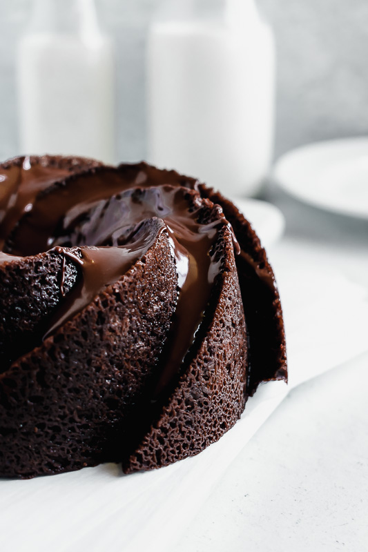 Small dark chocolate chip bundt cake on parchment paper