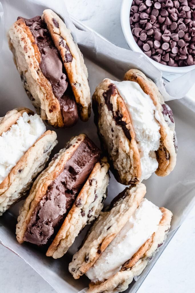 Chocolate chip cookie ice cream sandwiches with chocolate and vanilla ice cream