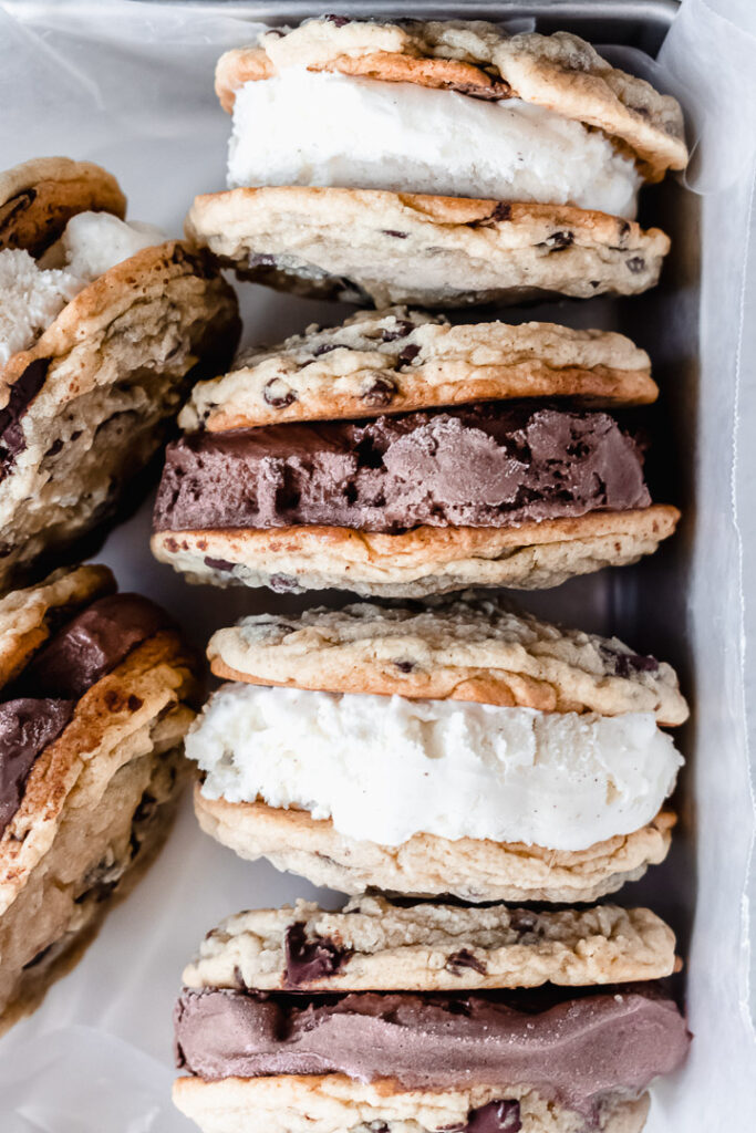 Chocolate chip cookie ice cream sandwiches in a tin pan