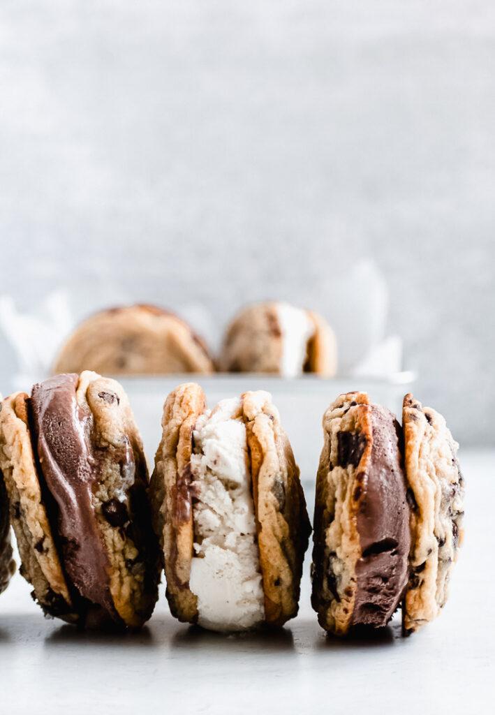 Homemade cookie ice cream sandwiches with chocolate and vanilla ice cream