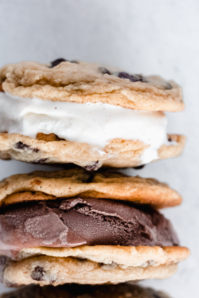 Ice cream melting between two cookies in a cookie ice cream sandwich