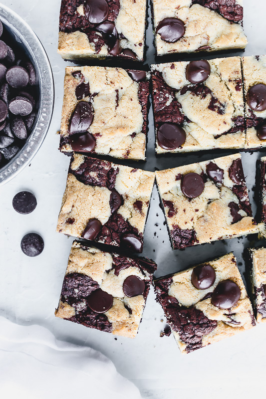 Chewy chocolate chip brookies with chocolate chips in a metal dish