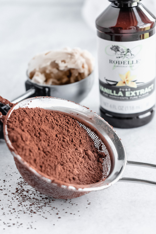 Rodelle vanilla extract and Rodelle cocoa powder in a sifter