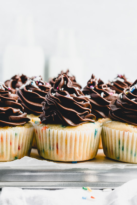 Funfetti cupcakes on a silver baking sheet