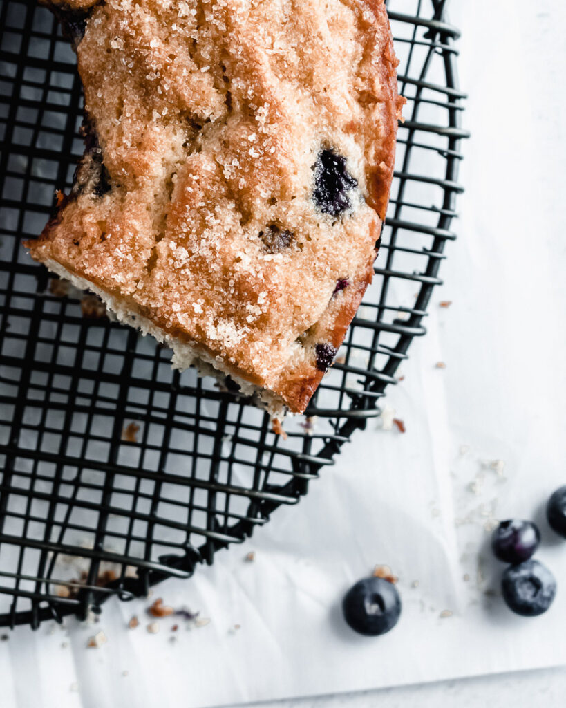 Slice taken out of blueberry mufin cake