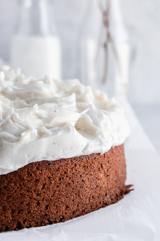 Close up of vanilla bean cream cheese frosting on spiced vanilla chai cake